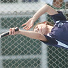 WARREN DILLAWAY /Star Beacon<br /> CAROLINE KOVACS of St. John serves during  first doubles action against Conneaut at Topky Courts in Ashtabula Tuesday.