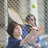 WARREN DILLAWAY / Star Beacon<br /> MATT PINELLI of St. John prepares to return a shot during first singles action with Scott Gerdes of  Conneaut on Tuesday at Topky Courts in Ashtabula.