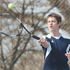 WARREN DILLAWAY / Star Beacon<br /> ALEX GERDES, of Conneaut returns a shot during third singles action with Joey Ferrante of St. John on Tuesday at Topky courts in Ashtabula.