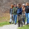 KAREN ADAIR, Central Lake Erie Watershed Project Manger for the Nature Conservancy (center foreground), leads (from left) Emily, Randy and Carol Jones and Kay Amey on a hike at Morgan Swamp on Saturday afternoon.  The hike was  part of the inaugural Ashtabula County Scenic Rivers Pilgrimmage held Saturday at various locations throughout the county.