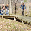 KAREN ADAIR, Central Lak Erie Watershed Project Manger for the Nature Conservancy, leads (from left) Randy Carol and Emily Jones on a hike at Morgan Swamp on Saturday afternoon.  The hike was  part of the inaugural Ashtabula County Scenic Rivers Pilgrimmage held Saturday at various locations throughout the county.