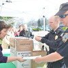 WARREN DILLAWAY / Star Beacon<br /> ASHTABUA POLICE officers Jason Erwin (second from right) and Tim Hoskins (right) work with Elaine Christen of Ashtabula County Medical Center (far left) collect outdated or no longer needed prescription drugs from the public on Saturday during an Ashtabula County Medical Center Health Fair at Kent State University-Ashtabula Campus.