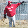 WARREN DILLAWAY / Star Beacon<br /> BILL LIPPS, Edgewood baseball coach, directs his team from the third base coaching box on Tuesday during a home game with Grand Valley.