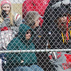WARREN DILLAWAY / Star Beacon<br /> EDGEWOOD BASEBALL fans try to stay warm on Tuesday during a chilly game in Ashtabula Township.