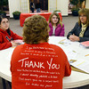 WARREN DLLLAWAY / Star Beacon<br /> CRAIG DUNN (back to camera), a volunteer for the Ashtabula chapter of the Amercan Red Cross talks with (from left) Amber Adams, of Painesville, Emelia Seibert, 11, and Nancy Gill, both of Kingsville Township, during an emergency awareness program on Saturday at Ashtabula Towne Square. The event was sponsored by Dominion.