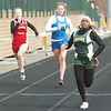 WARREN DILLAWAY / Star Beacon<br /> KARNEISHA PARTRIDGE (right) runs a heat of the 100 meter dash on Saturday during the Icebreaker Invitational at Lakeside on Saturday. She went on to finish third in the event.