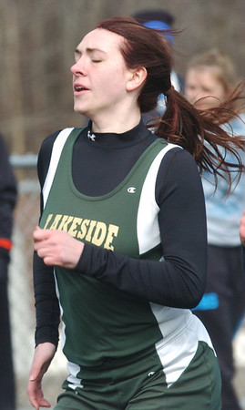 WARREN DILLAWAY / Star Beacon<br /> ALEXIS BENEDICT of Lakeside runs a heat of the 200 meter dash on Saturday during the Icebreaker Invitational at Lakeside on Saturday. She went on to finish sixth in the event.