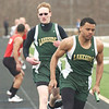 WARREN DILLAWAY / Star Beacon<br /> OTIS CONEL of Lakeside takes the baton from teammate Caleb Henery on Saturday during the Icebreaker Invitational at Lakeside.