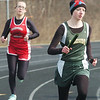 WARREN DILLAWAY / Star Beacon<br /> KRISTEN BERUS (right) of Lakeside and Savannah Spring of Edgewood race in the 4 x 800 meter relay on Saturday at the Icebreaker Invitational at Lakeside.