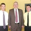 WARREN DILLAWAY / Star Beacon<br /> DAVID FLAUTT (center) presented Austin (left) and Grant Nowakowski with the Edward Jones/David Flautt Scholarship on Sunday during the Ashtabula County Basketball Foundation Awards Dinner in Conneaut.