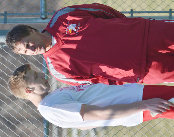 WARREN DILLAWAY / Star Beacon<br /> RICK EBERSOLE of Geneva talks with coach Duane Dubsky during a singles match against Willoughby South on Tuesday.