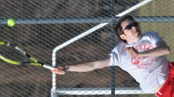 WARREN DILLAWAY / Star Beacon<br /> BRENT MCFARLAND of Geneva serves during a home second singles match against Willoughby South on Tuesday in Geneva.