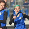 WARREN DILLAWAY / Star Beacon<br /> MALLARIE FERNANDEZ (right) takes the baton from Grand Valleyy teammate Samantha Truckley on Tuesday during a home meet in Orwell.