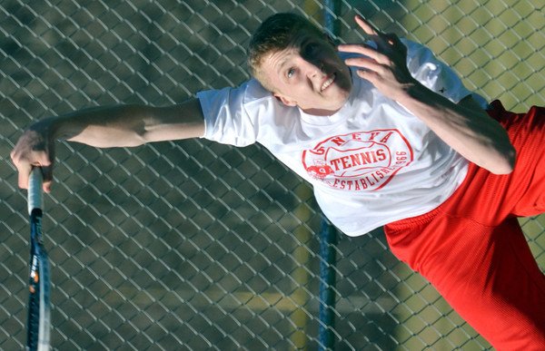 WARREN DILLAWAY / Star Beacon<br /> RICK EBERSOLE of Geneva serves during a home first singles match against Willoughby South on Tuesday.