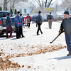 WARREN DILLAWAY / Star Beacon<br /> DOUG LONG blows leaves through the parking lot at Grand River Academy in Austinburg Township.