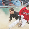 WARREN DILLAWAY / Star Beacon<br /> COLE ERDEL (right) of Jefferson slides safely home as Zane Chance of Girard looks for the ball on Monday afternoon at Havens Complex in Jefferson Township.