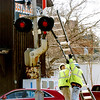 WARREN DILLAWAY / Star Beacon<br /> CSX CREWS prepare to work on a railroad crossing signal on North Broadway in Geneva on Friday afternoon.