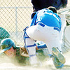 WARREN DILLAWAY / Star Beacon<br /> AUSTIN DIBELL (facing) of Lakeside gets tagged out by Stanley Sirrine of Grand Valley on Friday in Orwell.