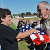 WARREN DILLAWAY / Star Beacon<br /> JENNIE LUTE, winner of the Ashtabula County Fair Best of Show Quilt, presents the quilt to veteran Kenneth Babcock during a Purple Heart Dedication Service on Friday afternoon at the Ashtabula County Fair in Jefferson.
