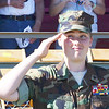 WARREN DILLAWAY / Star Beacon<br /> DAVID SAWDEY of the Ashtabula County Young Marines salutes during a flyover that kicked off a Purple Heart Dedication Service at the Ashtabula County Fair.