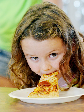 WARREN DILLAWAY / Star Beacon<br /> JORDAN FETTERS, 6, of New Lyme Township won the eight and under division of the Ashtabula County Fair Pizza Eating Contest on Friday afternoon in Jefferson.