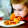 WARREN DILLAWAY / Star Beacon<br /> LOUIE  ALBEE, 5, of Austinburg Township, participates in the eight and under division of the Ashtabula County Fair Pizza Eating Contest on Friday afternoon in Jefferson.