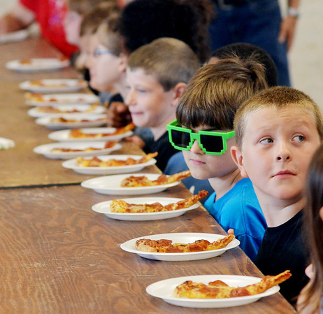 WARREN DILLAWAY / Star Beacon<br /> PARTICIPANTS IN  the eight and under division of the Ashtabula County Fair Pizza Eating Contest prepare for the challenge on Friday afternoon in Jefferson.
