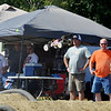 WARREN DILLAWAY / Star Beacon<br /> DRIVERS AND fans watch a car fly through the air during a national remote control car competition along Dibble Road in Kingsville Township.