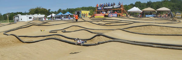 WARREN DILLAWAY / Star Beacon<br /> CARS FLY through the air during a national remote control car competition along Dibble Road in Kingsville Township.