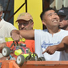 WARREN DILLAWAY / Star Beacon<br /> KWANG KIM of Akron signals to his driver during during a national remote control car competition along Dibble Road in Kingsville Township.