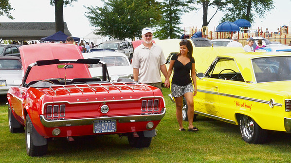 WARREN DILLAWAY / Star Beacon<br /> CURTIS CONER and Michelle Daly, both of Mercer, PA., check out the Saybrook Classic Cruisers 8th Annual Cruisein for Autism Sock Hop on Saturday at Saybrook Township Park.