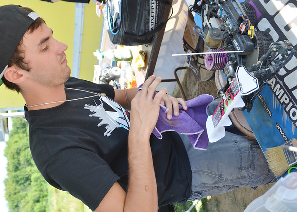WARREN DILLAWAY / Star Beacon<br /> BARRY PETTIT of Spartanburg, S.C., a professional remote control car racer, works with a car during a national competition in Kingsville Township on Saturday.