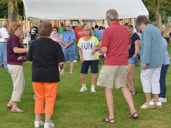 WARREN DILLAWAY / Star Beacon<br /> DANCING WAS one of the fun possibilities at the Saybrook Classic Cruisers 8th Annual Cruisein for Autism Sock Hop on Saturday at Saybrook Township Park.
