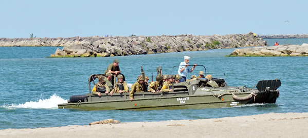 WARREN DILLAWAY / Star Beacon<br /> LANDING CRAFT bring World War re-enactors to shore on Saturday during D-Day Conneaut.