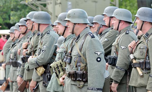WARREN DILLAWAY / Star Beacon<br /> WORLD WAR II  re-enactors prepare for battle on Saturday during D-Day Conneaut at Conneaut Township Park.