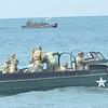 WARREN DILLAWAY / Star Beacon<br /> LANDING CRAFT bring World War re-enactors to shore on Saturday during D-Day Conneaut.