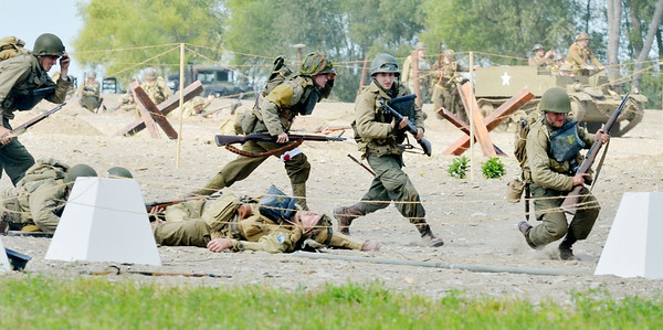 WARREN DILLAWAY / Star Beacon<br /> AMERICAN SOLDIERS (re-enactors) rush the beach during D-Day Conneaut on Saturday at Conneaut Township Park.