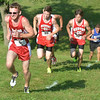 WARREN DILLAWAY / Star Beacon<br /> JOSH MORGAN of Edgewood (left) leads a group of runners up a hill during the War on the Shore at Lake Shore Park in      Ashtabula on Monday afternoon.