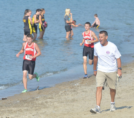 WARREN DILLAWAY / Star Beacon<br /> STEVE LOCY, Jefferson cross country coach, yells to his runners on Monday during the War on the Shore at Lake Shore Park in Ashtabula Township.