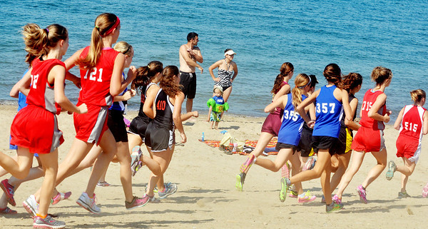 WARREN DILLAWAY / Star Beacon<br /> A FAMILY takes time from swimming to watch the War on the Shore cross country meet on Monday afternoon at Lake Shore  Park in Ashtabula Township.