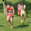 WARREN DILLAWAY / Star Beacon<br /> ZACH LEMAY of Edgewood (left) leads a group of runners up a hill during the War on the Shore at Lake Shore Park in      Ashtabula on Monday afternoon.