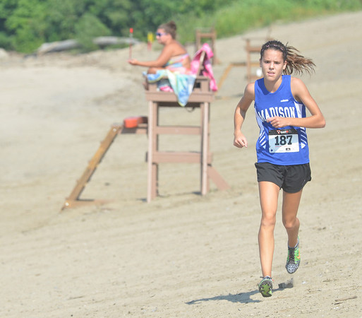WARREN DILLAWAY / Star Beacon<br /> HILLARY REIGLE of Madison runs on the beach on Monday during the War on the Shore at Lake Shore Park in Ashtabula Township.