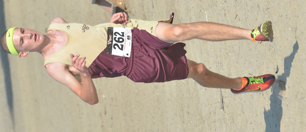 WARREN DILLAWAY / Star Beacon<br /> CORY MIENTKIEWICZ of Pymtuning Valley sprints to the finish line of the War on the Shore on Monday at Lake Shore Park in Ashtabula Township.