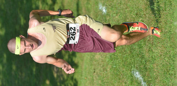 WARREN DILLAWAY / Star Beacon<br /> CORY MIENTKIEWICZ of Pymatuning Valley runs up a hill during the War on the Shore on Monday at Lake Shore Park in Ashtabula Township.