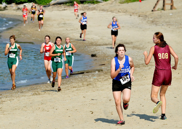 WARREN DILLAWAY / Star Beacon<br /> ABBY HAMILTON of Pymatuning Valley (right) runs backward on the sand with Scarlet Pollock of Madison during the War on the Shore at Lake Shore Park in Ashtabula Township.