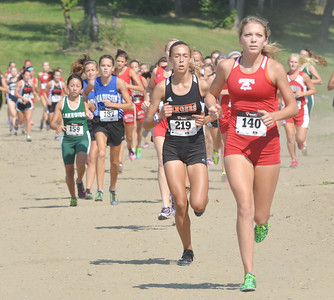 WARREN DILLAWAY / Star Beacon HAILEY VAN HOY (140) of Geneva leads the girls race on Monday during the War on the Shore at Lake Shore Park in Ashtabula Township.