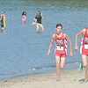 WARREN DILLAWAY / Star Beacon<br /> CHRIS LEMAY (3) and his twin Josh lead the War on the Shore as girl runners cool off in Lake Erie during the War on the Shore at Lake Shore Park in Ashtabula Township.