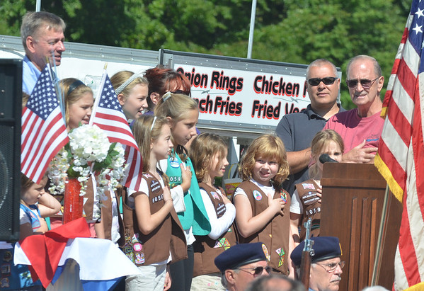 WARREN DILLAWAY / Star Beacon<br /> GIRL SCOUT recite the pledge of allegiance to help start the North Kingsville centennial celebration on Saturday morning.