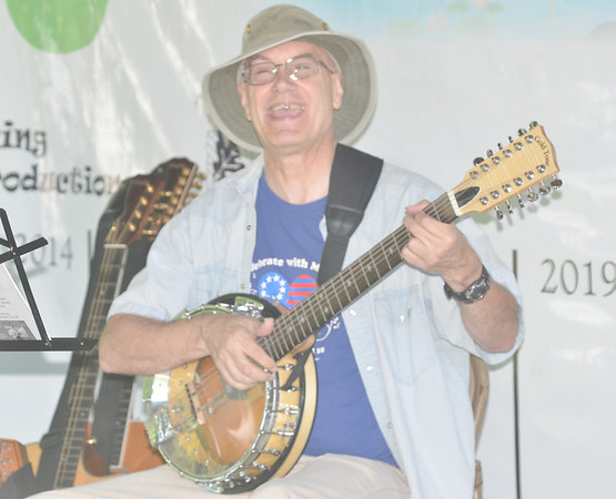 WARREN DILLAWAY / Star Beacon<br /> BILL SCHILLING belts out a Woody Guthrie song during Music on the River at Harpersfield Metropark on Saturday. The event continues this morning at 9 a.m. with a variety of acoustic music ranging from Bluegrass to Celtic.
