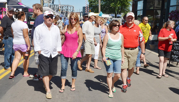 WARREN DILLAWAY / Star Beacon<br /> TOURISTS AND area residents mixed on Bridge Street Saturday during the Wine and Walleye Festival.